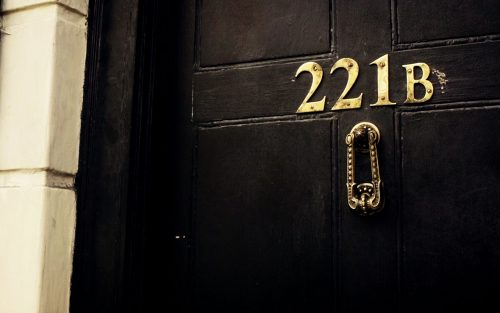 An image of a black door with the number 221b on it
